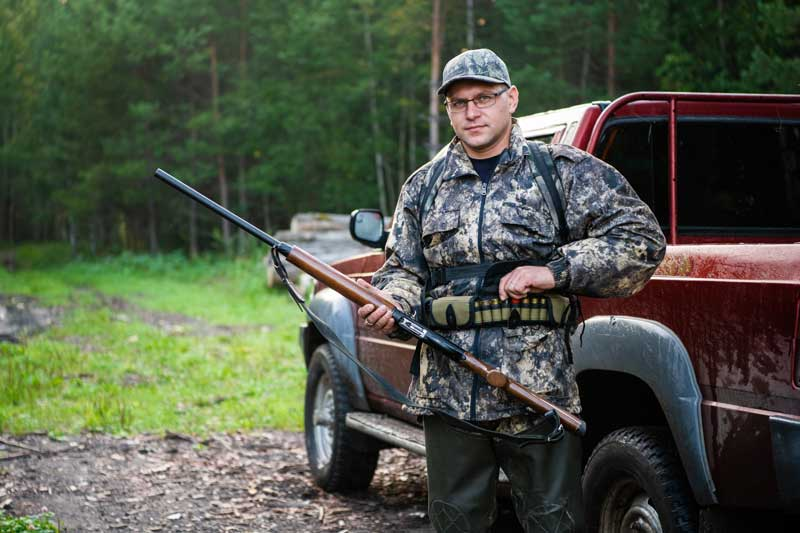 man-goes-hunting-to-the-forest-in-summer-huntsman--DNYTED2.jpg
